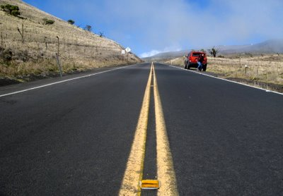 The road to Mauna Kea was a steady climb into the thin atmosphere and along the way we had to stop many times to take pictures of the scenery that changed with the altitude. Here is DD and the Big Bad Boy Dodge Nitro and of course a close-up of one of the intriguing reflectors on the road that somehow interested us! DAMI took this pic.
