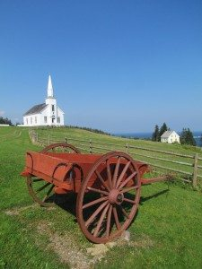 Gaelic church and farm buggy overlooking Bras D'or Lake on Cape Breton Island