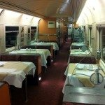 The dining car on the train is great! There are real tables, full service, a nice view and you might sit with someone with a story to tell!