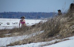 You gotta be tough to survive winters in Canada and here in New Brunswick even pack ice and snow covered beaches won't stop someone from getting down to a bikini to do some snow surfing!