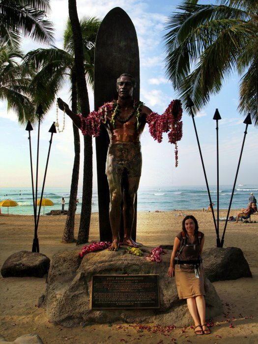 DD under the statue of Duke, one of the most famous Hawaiian sports figures of recent history. The statue on Waikiki beach has a webcam pointed at it and is always popular with tourists like us!