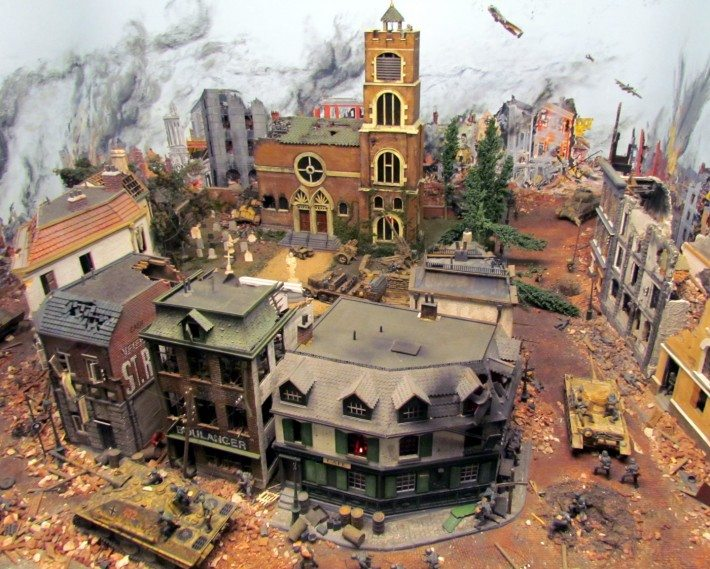A miniature display of a World War II village ravaged by the war in France. The realistic figures in the streets really create an atmosphere of battle and destruction.