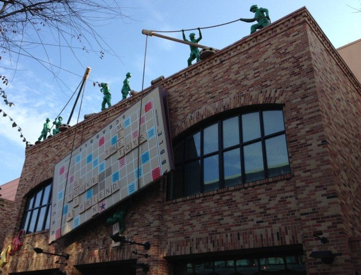 There is a huge Scrabble board on the side of a building with green plastic toy soldiers hoisting up the letters to spell fun words! It was really getting us stoked up for Toy Story!