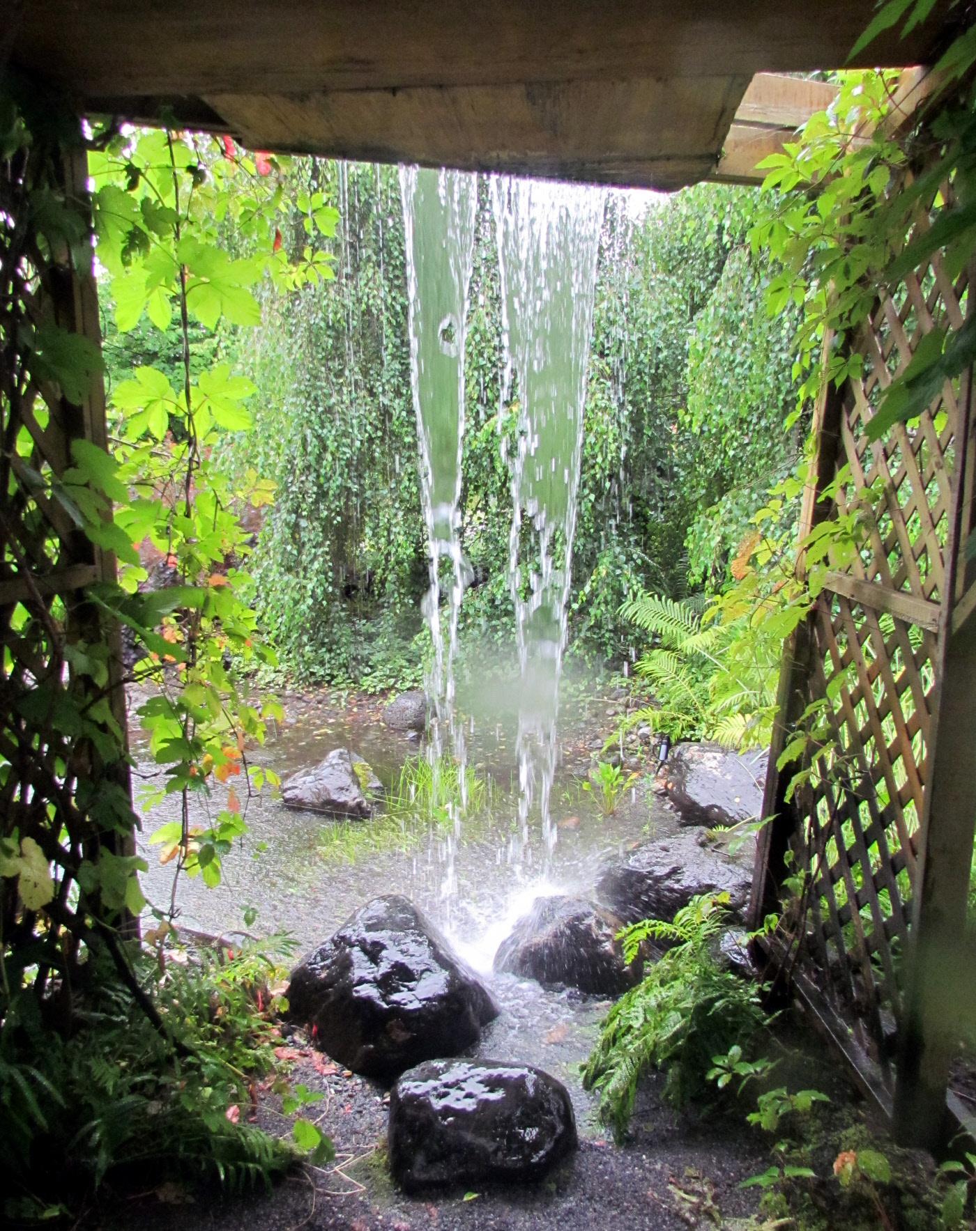 Scullion garden waterfall travels trips tails for Garden waterfall