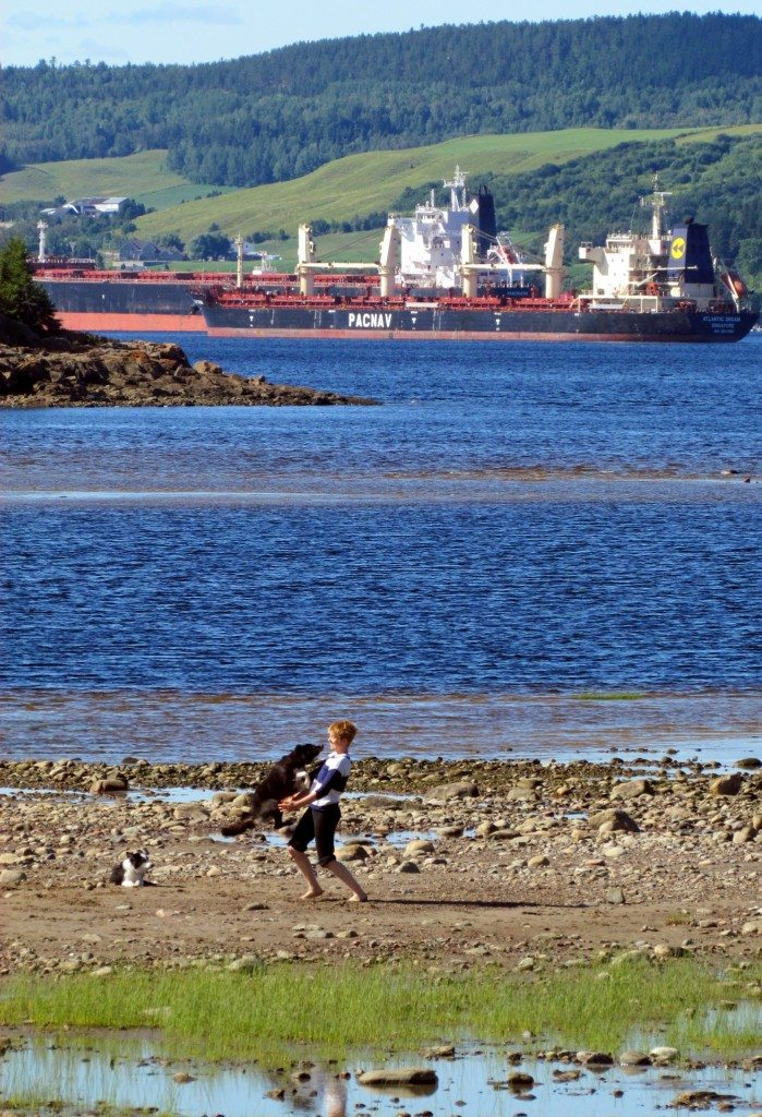 Woman and Dog on the Beach at La Baie