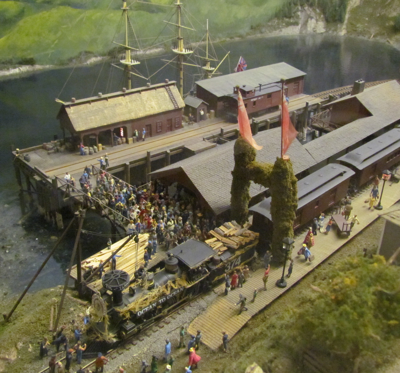 Boats dock at the wharf and townsfolk crowd together to board the train into towm. The dioramas at Miniature World are amazingly detailed and this scene shows a crowd and you can really imagine the pushing and shoving and noises of the moment captured in miniature!