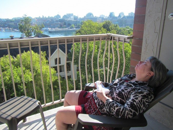 Mama D resting on the balcony after a long day of flights across Canada